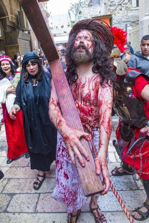 JERUSALEM - APRIL 14 : Christian pilgrims re-enact the crucifixtion of Jesus along the Via Dolorosa in Jerusalem during Good friday on April 14 2017 Editorial