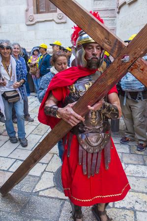 JERUSALEM - APRIL 14 : Christian pilgrim re-enact the crucifixtion of Jesus along the Via Dolorosa in Jerusalem during Good friday on April 14 2017
