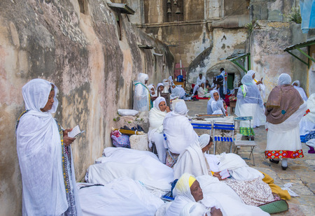 JERUSALEM - APRIL 15 : Ethiopian Orthodox worshipers waiting for the Holy fire ceremony to begin at the Ethiopian section of the Holy Sepulcher in Jerusalm Israel on April 15 2017 Editorial