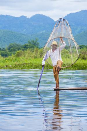 INLE LAKE , MYANMAR - SEP 07 : Burmese fisherman at Inle lake Myanmar on September 07 2017 , inle Lake is a freshwater lake located in Shan state Editorial
