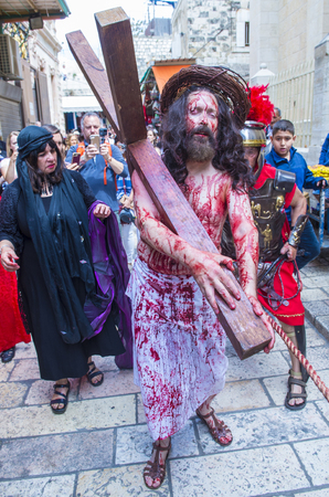 JERUSALEM - APRIL 14 : Christian pilgrims re-enact the crucifixtion of Jesus along the Via Dolorosa in Jerusalem during Good friday on April 14 2017 Editorial