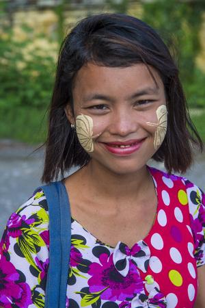 MANDALAY , MYANMAR - SEP 03 : Portrait of Burmese girl with thanaka on face on Mandalay Myanmar on September 03 2017. Thanaka is paste made from ground bark Editorial