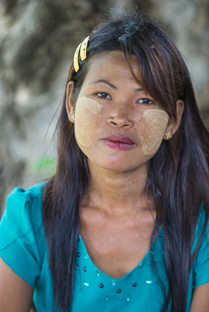 MANDALAY , MYANMAR - SEP 03 : Portrait of Burmese girl with thanaka on face on Mandalay Myanmar on September 03 2017. Thanaka is paste made from ground bark Editorial