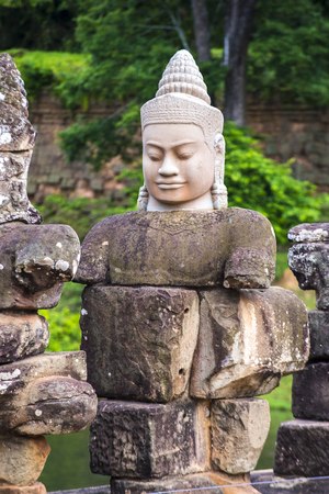 SIEM REAP , CAMBODIA - OCT 15 : Statue at the South Gate of Angkor Thom, Siem Reap Cambodia on October 15 2017 , Angkor Thom was the last and capital city of the Khmer empire.