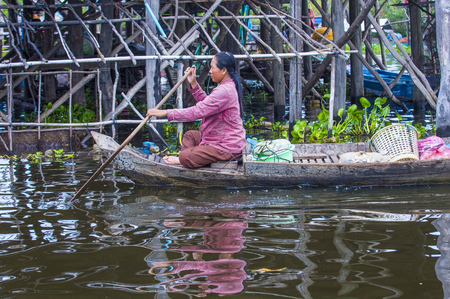 TONLE SAP , CAMBODIA - OCT 18 : Cambodian woman in Tonle sap lake Cambodia on October 18 2017. Tonle sap It is the largest lake in South East Asia