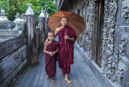 MANDALAY , MYANMAR - SEP 02 : Monks at Shwenandaw Monastery in Mandalay, Myanmar on September 02 2017. Shwenandaw Monastery is a historic monastery located near Mandalay Hill Editorial