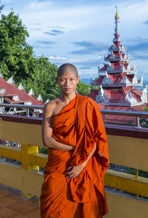 MANDALAY , MYANMAR - SEP 03 : Buddhist Novice Monk on Mandalay Hill in Myanmar on September 03 2017 , Mandalay Hill is a major pilgrimage site.