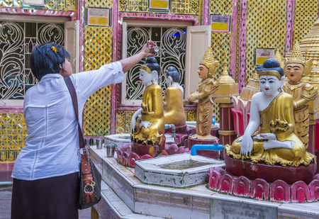 MANDALAY , MYANMAR - SEP 03 : Interior of temple on the Mandalay Hill in Myanmar on September 03 2017 , Mandalay Hill is a major pilgrimage site.