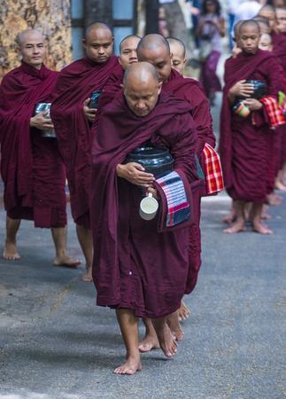 AMARAPURA , MYANMAR - SEP 03 : Monks at the Mahagandayon Monastery in Amarapura Myanmaron September 03 2017 , Mahagandayon Monastery has 2000 monks at any given time.