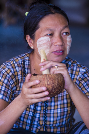 BAGAN, MYANMAR- SEP 04 : Woman smoking a cheroot cigar in market in bagan, Myanmar on September 04, 2017. Cheroot is a cigar made by dried fruits and little bit of tobacco