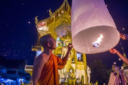 CHIANG MAI , THAILAND - NOV 03 : Buddhist monk launch sky lantern during Yee Peng festival in Chiang Mai , Thailand on November 03 2017