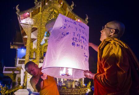 CHIANG MAI , THAILAND - NOV 03 : Buddhist monks launch sky lantern during Yee Peng festival in Chiang Mai , Thailand on November 03 2017