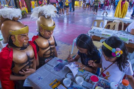 BOAC , PHILIPPINES - MARCH 30 : children decorating masks during the Moriones festival in Boac Marinduque island the Philippines. The Moriones festival held anualy on the Holy Week