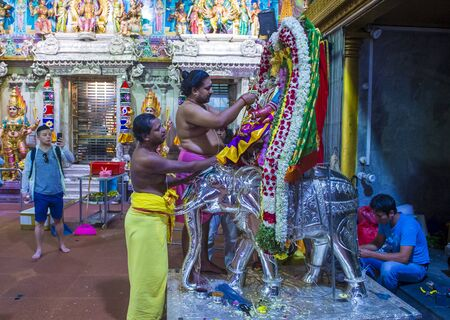 SINGAPORE - FEB 24 : Indian men decorating idol in Sri Veeramakaliamman temple in Little India, Singapore on February 24 2018 It is one of the oldest temples in Singapore.