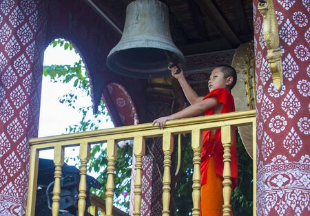 LUANG PRABANG , LAOS - AUG 12 2018 : Novice monk in Luang Prabang Laos on August 12 2018. It is estimated that about 1 in 3 male Laotians join a monastery at least for a while Editöryel