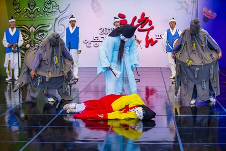 ANDONG , SOUTH KOREA - OCT 01 : Actors performing the traditinal Korean Maskdance at Andong South Korea on October 01 2018 , The Maskdance festival held in Andong annually