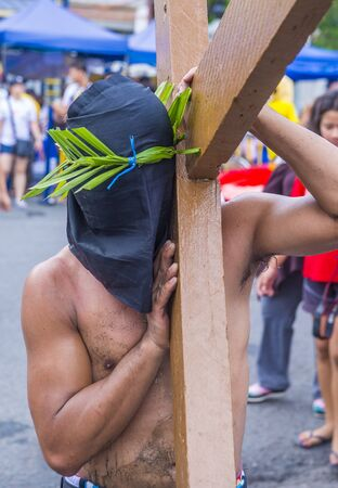 PAMPANGA , PHILIPPINES - APRIL 19 : Filippino Participant in a Good Friday crucifixion re-enactment in Pampanga The Philippines on April 19 2019 Publikacyjne