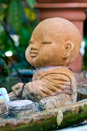 novice: Little novice statue at temple, Thailand.