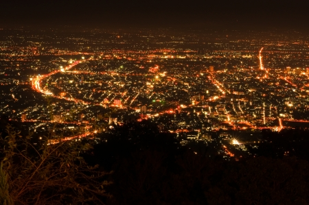 bird's eye view: Bird eye view above Chiengmai city in night, Thailand. Stock Photo