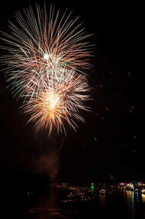 Colorful Fireworks in night at Bangpakong river, Chachoengsao province, Thailand. photo