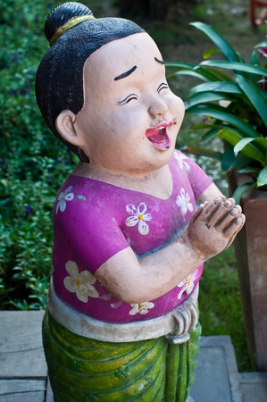 thai boy: Thai boy sculpture at floating market, Thailand. Stock Photo