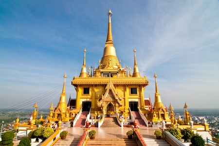 Beautiful golden pagoda with blue sky, THailand.