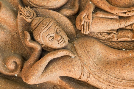 Reclining buddha made from earth, Thailand. Stock Photo - 8601699