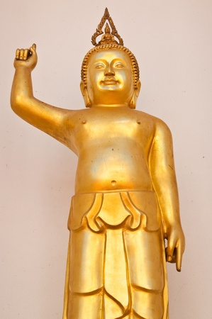 Golden buddha point to the sky, Thailand. photo
