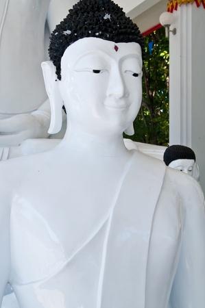 Beautiful white buddha in Thailand. photo