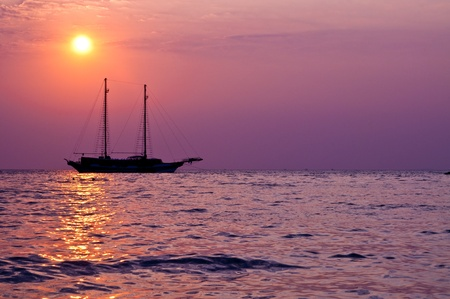 Silhouette of boat in beautiful light, Thailand. photo