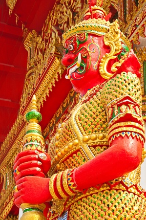 Red giant and golden dress, Thailand. Stock Photo - 8859206