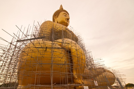 Renovation of big buddha statue at Wat Muang, Thailand. Stock Photo - 9628944
