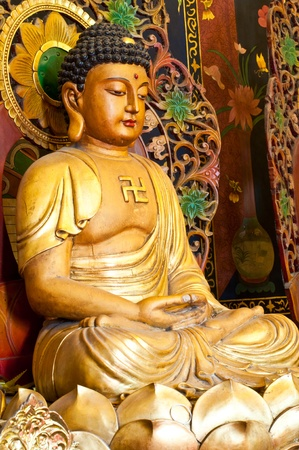 Chinese buddha statue at the Thai temple, Thailand. Stock fotó