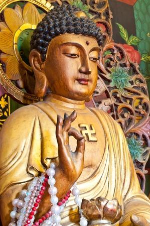 Chinese buddha statue at the Thai temple, Thailand. photo