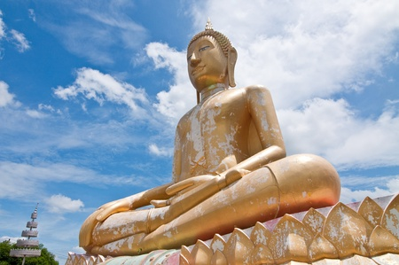 Beautiful golden buddha statue with blue sky, Thailand. Stock Photo - 9862283