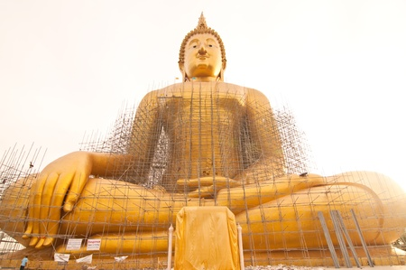 Renovation of big buddha statue at Wat Muang, Thailand. photo