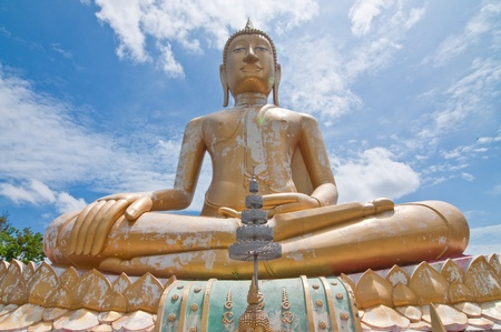Beautiful golden buddha statue with blue sky, Sra-ket temple, Angthong Province, Thailand. Stock Photo - 10023240