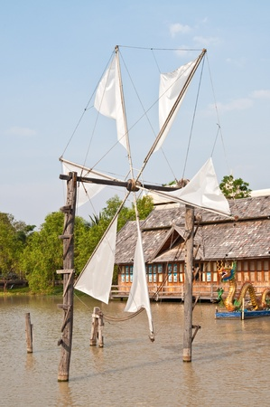Thai style windmill with blue sky, Thailand. photo