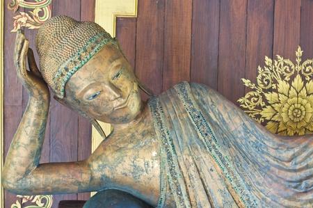 Reclining buddha made from wood, Thailand. Stock Photo - 10455259