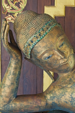 Face of reclining buddha made from wood, Thailand. Stock Photo - 10451210