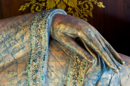 Hand of reclining buddha made from wood, Thailand. Stock Photo - 10455262