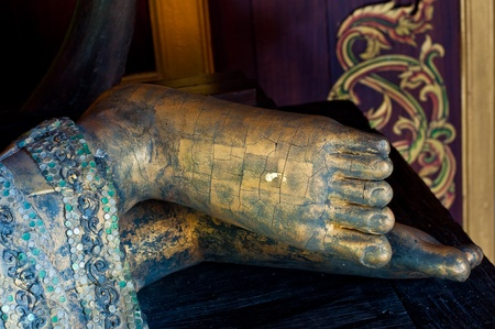 Foot of reclining buddha made from wood, Thailand. Stock Photo - 10451113