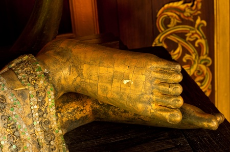 Foot of reclining buddha made from wood, Thailand. Stock Photo - 10451207