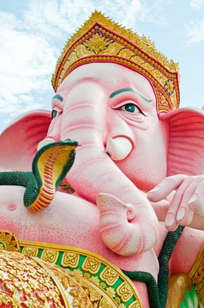 Face of pink ganesha statue in relaxing action, Thailand. photo