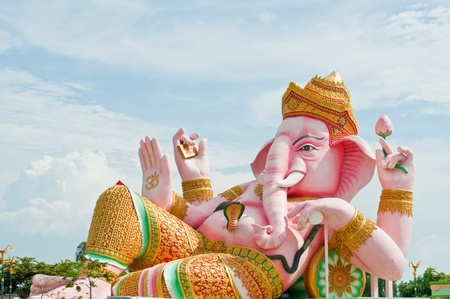 Pink ganesha statue in relaxing action, Thailand. photo