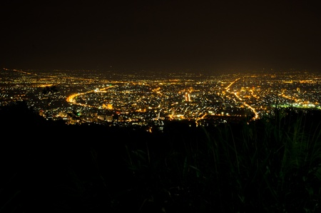 Bird eye view above Chiengmai city in night, Thailand. photo