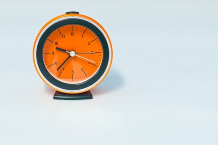 Orange clock on white screen, Thailand. photo
