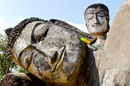 Face of ancient reclining buddha in historical park, Kamphaengphet province, Thailand. photo