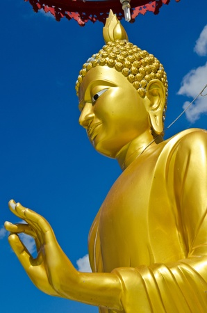 Golden buddha statue with blue sky, Thailand. Stock Photo - 12461080