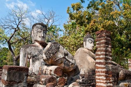 Three buddha statues in historical park, Kamphaengphet province, Thailand. photo